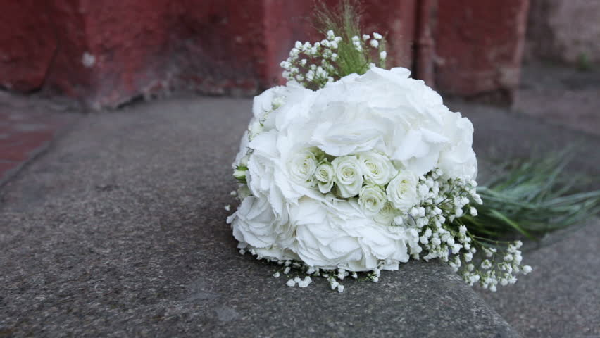 Traffic cameras to the wedding bouquet and back. Bouquet lies on the granite floor | Shutterstock HD Video #4645238