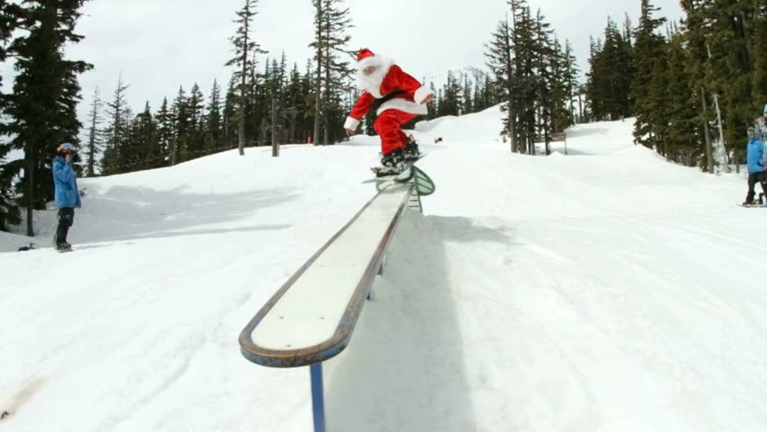 Santa Claus shredding in snowboard park