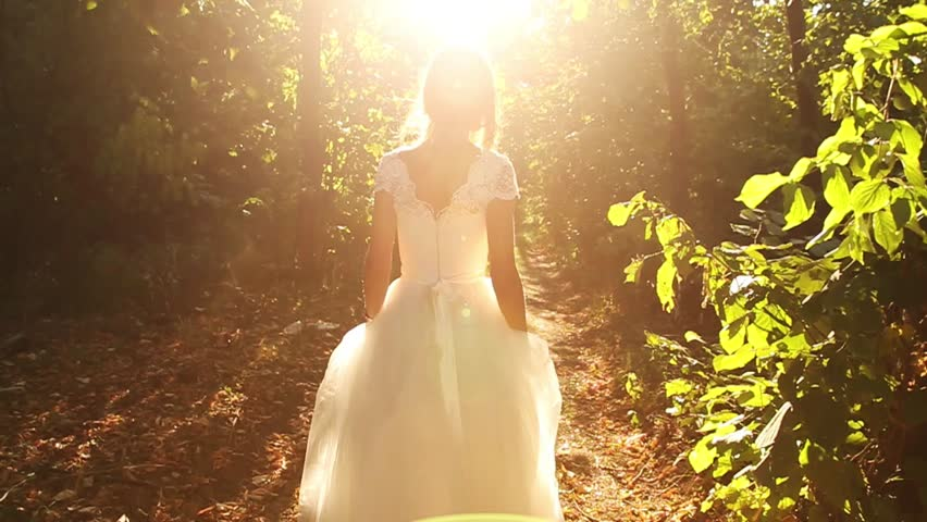 Young Woman Beauty Running in Forest Runaway Bride Concept