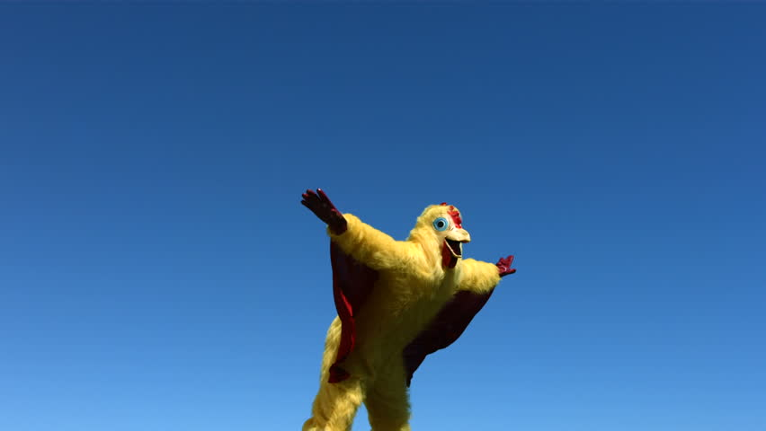 Person in chicken costume jumps in the air, slow motion