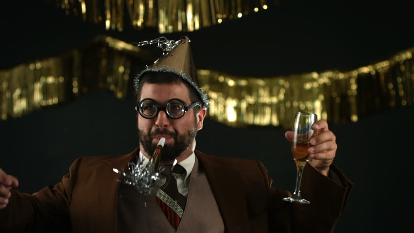 Nerdy man at New Years party, slow motion | Shutterstock HD Video #4655453
