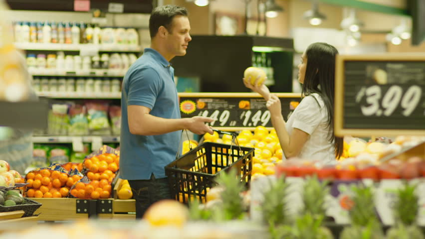 Happy couple have fun shopping for fresh vegetables. Medium shot. | Shutterstock HD Video #4655633