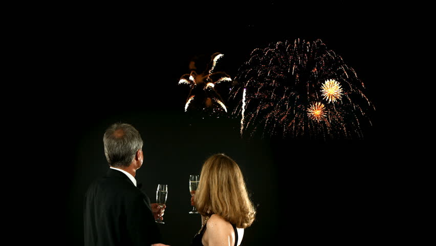 Mature couple watching fireworks on New Year's Eve