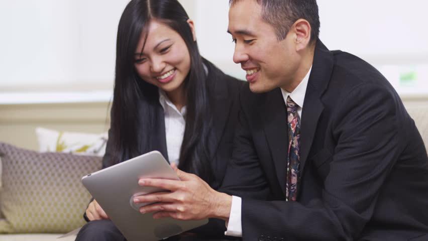 Business people use digital tablet together