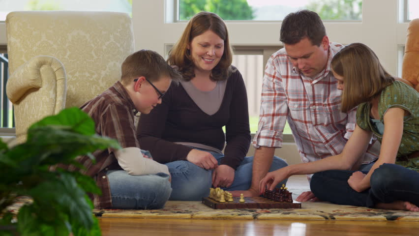 Family at home playing game together