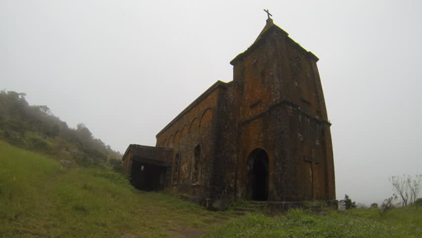 Abandoned Catholic Church on the  top of Bokor Hill station close to Kampot Cambodia. This Church was built by the French in 1920