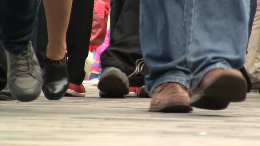 Low angle view of crowd foot traffic on sidewalk close up