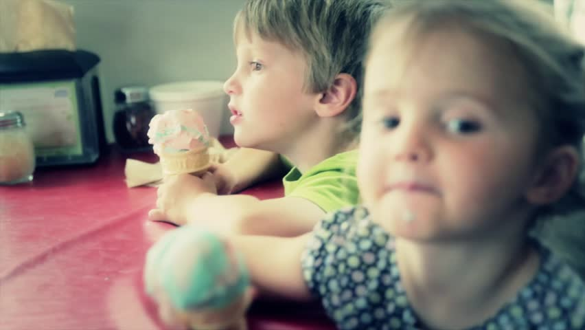 A family at the ice cream parlor enjoying ice cream cones