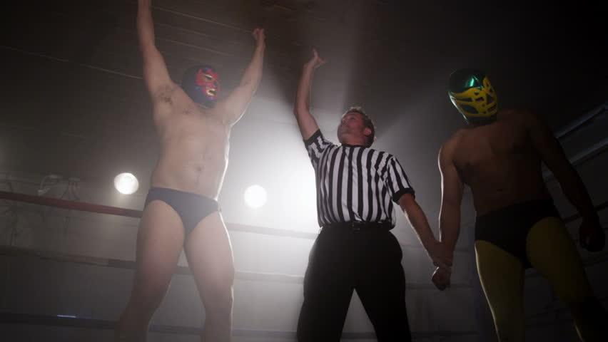 Referee announces winner of wrestling match