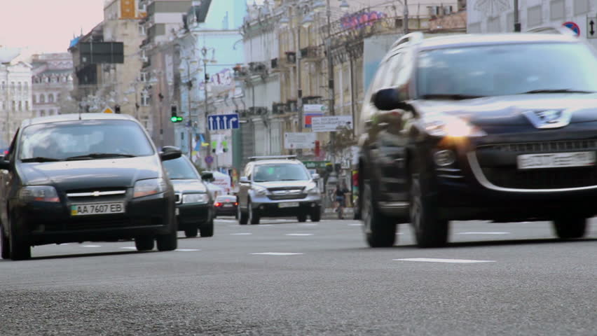 City street at daytime, cars drive slow, speed limit restriction
