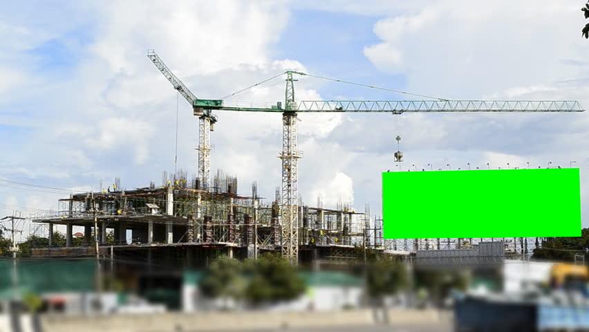 big green screen billboard and construction site