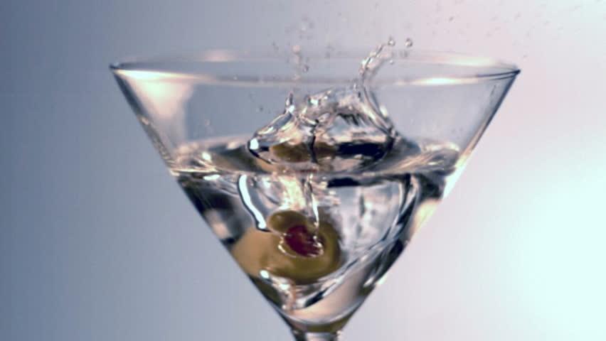 Slow motion olive splash