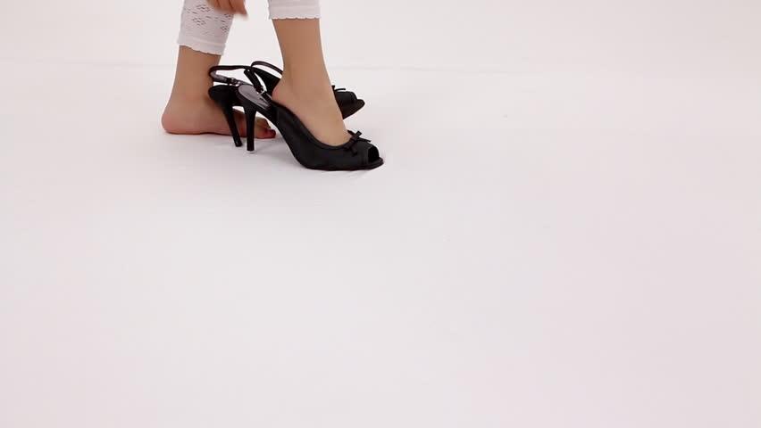 Little girl on a black high heels