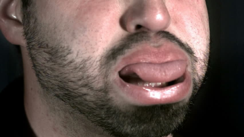 Closeup of man spitting with tongue out, slow motion #4712063