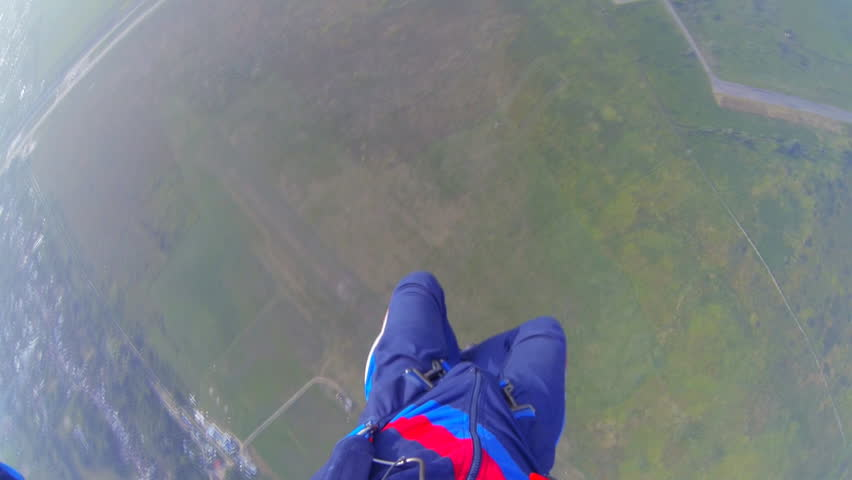 Video parachute jumps (skydiving) from a first-person video shooting process parachute opens in the first person | Shutterstock HD Video #4714241