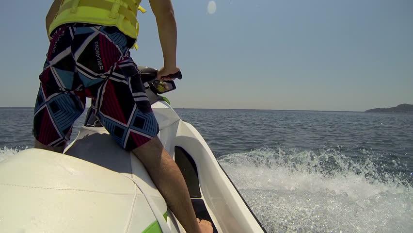 Jet ski driver standing back view