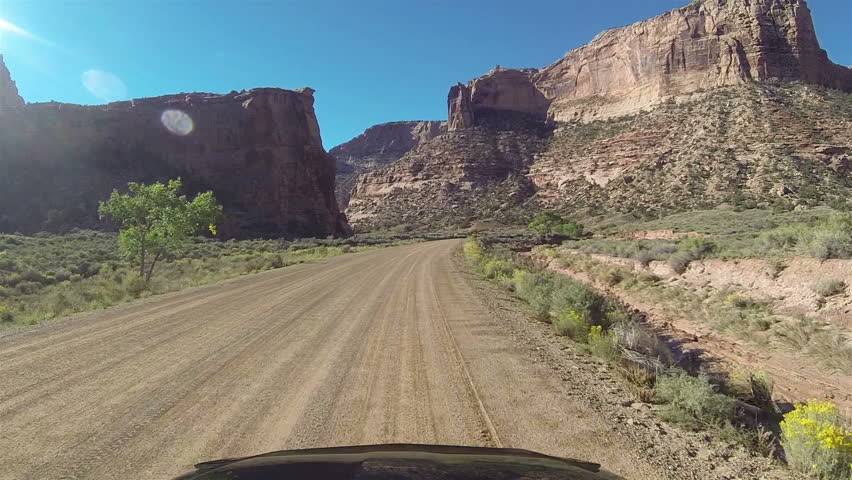 Driving San Rafael Buckhorn Wash Utah point of view. Hood of car desert dirt road POV. Camera mounted outside of car. Vacation travel in southwestern Utah desert. Dirt road in San Rafael Swell.