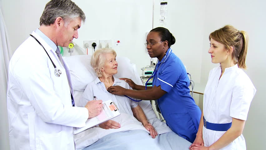 Nurses Check Elderly Patient's Vital Signs And Blood ...