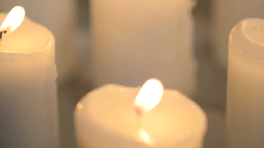 Closeup Shot Of A Single White Candle Burning With Soft Candle Light. Candle Wax