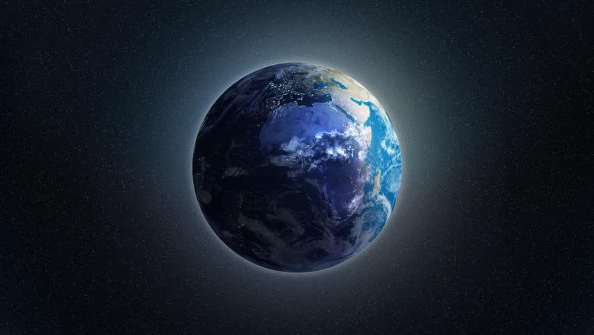 Zoom at rotating Earth with visible city lights at night