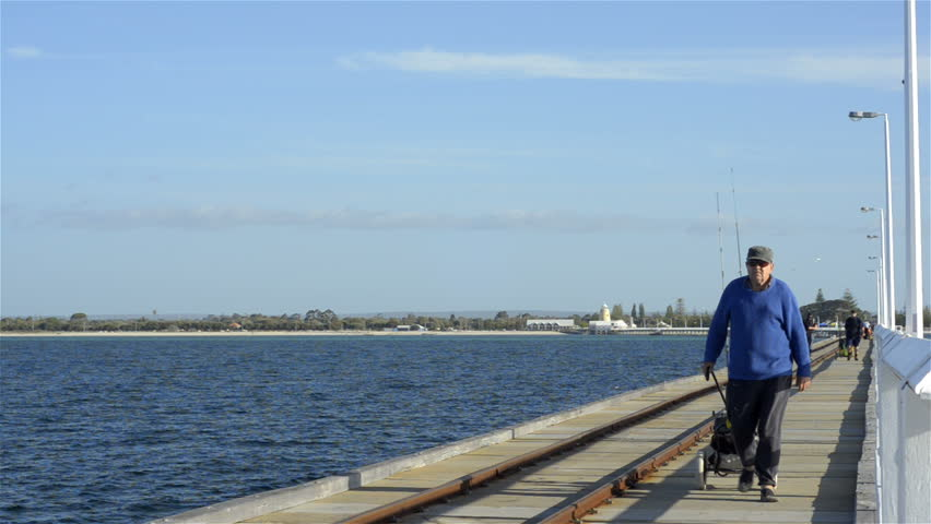 People fishing off jetty stock footage video shutterstock for Videos of people fishing