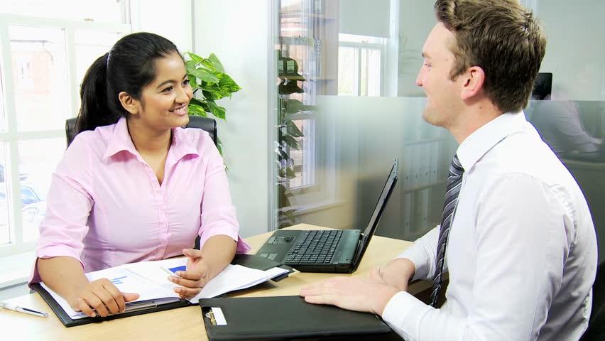 Male Human Resources Representative Interviewing Young South Asian – Human Resources Representative