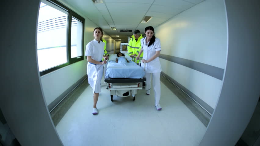 doctors and medical staff are running urgently through a