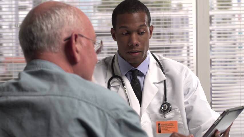 Doctor holding a tablet talking to patient #4830443