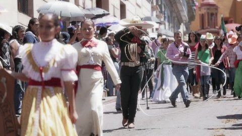 GUANAJUATO, MEXICO - 28 SEPTEMBER 2013: Mexican charro practices his lasso during parade DESFILE DE GUANAJUATO 2013