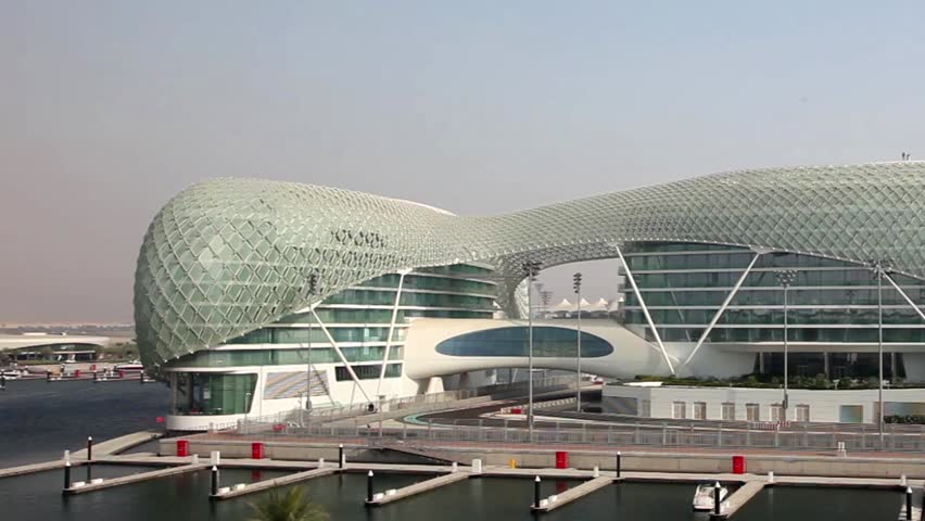 ABU DHABI, UAE - JAN 7: Yas Marina Hotel - modern luxury hotel at Abu Dhabi's Grand Prix Race Circuit on Jan 7, 2010 in Abu Dhabi, UAE. It is first hotel in the world that is built over a race circuit