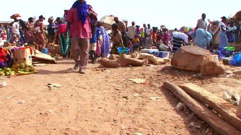 MALI-CIRCA 2012-A crowded and busy public market in Mali, Africa. POV