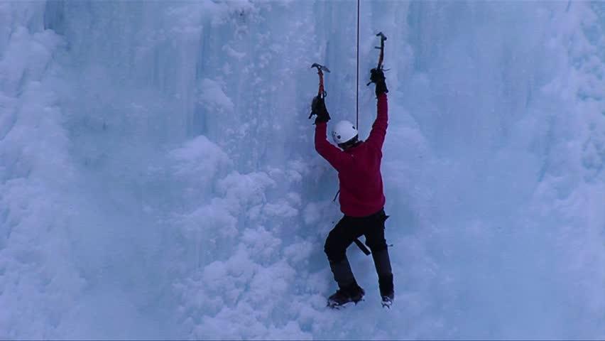 ONTARIO, CANADA-CIRCA 2012-A man climbing a frozen waterfall.