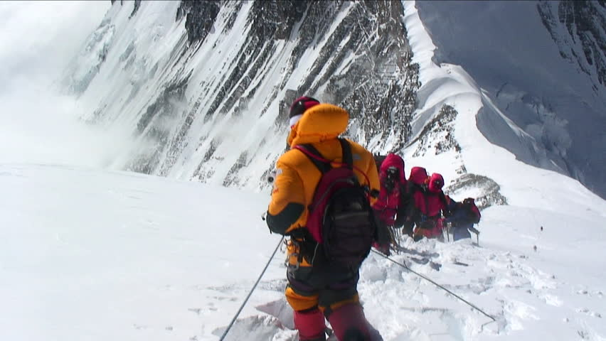 MT. EVEREST - CIRCA 2010: Climbers stuck and turning back in high winds