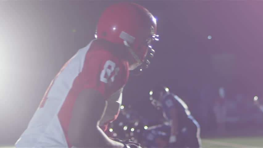 Close up tracking shot of a football player catching a pass while being defended | Shutterstock Video #4892540