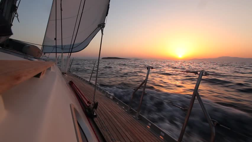 Sailing In The Wind Through The Waves During Sunset Hd