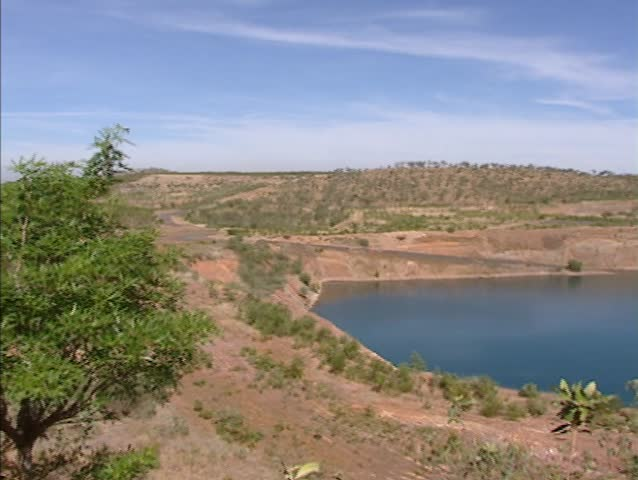 Pine Creek, Australia: Pan closed open-cut gold mine pit, filled with water.   Shutterstock HD Video #4896023