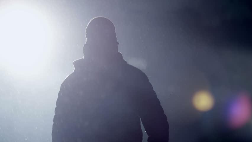 Man goes through the smoke at night