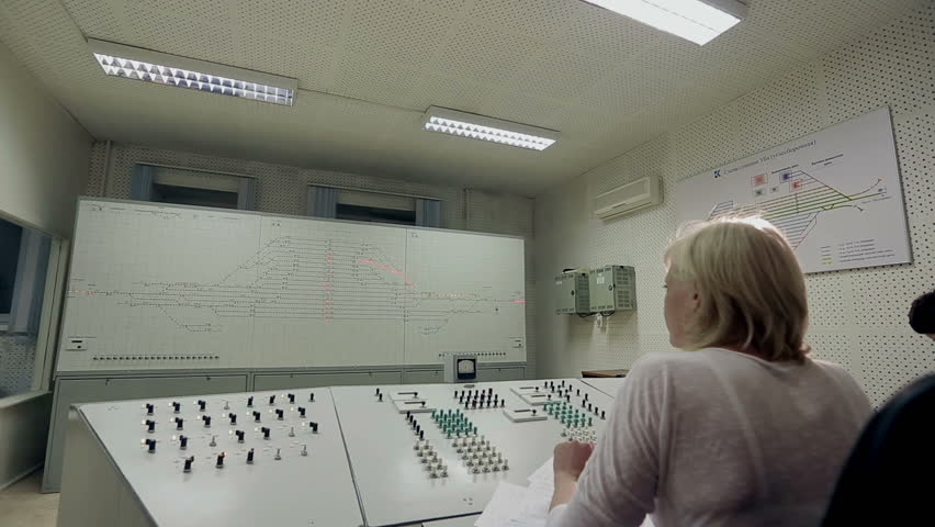 Dispatcher of electric trains presses the button of the panel