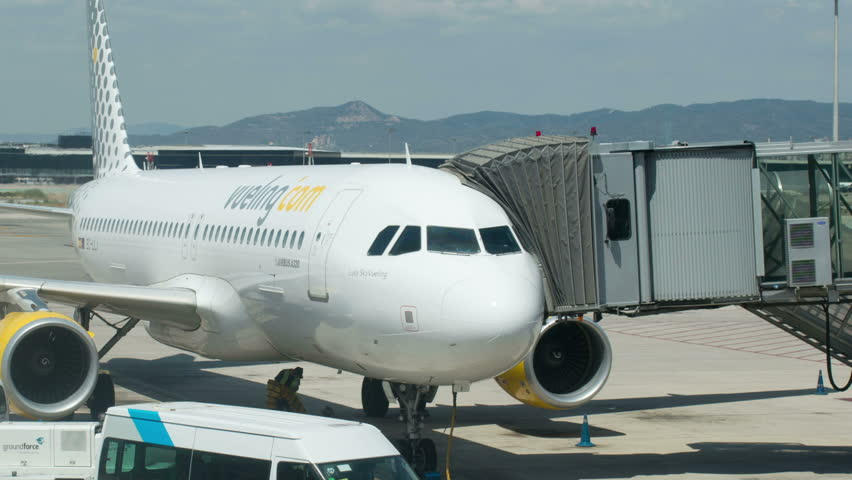 BARCELONA - CIRCA 2013: timelapse of a flight getting ready for departure at barcleona airport
