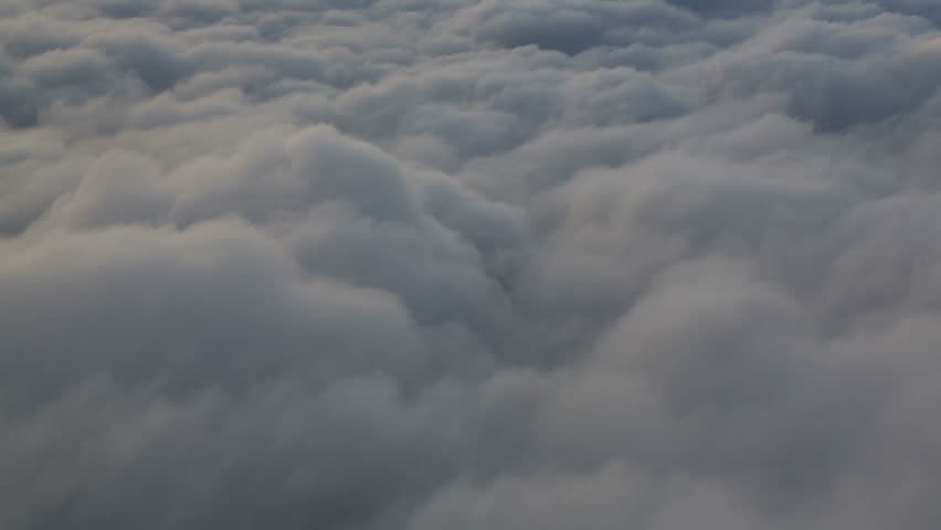 Side view shot of flying above clouds