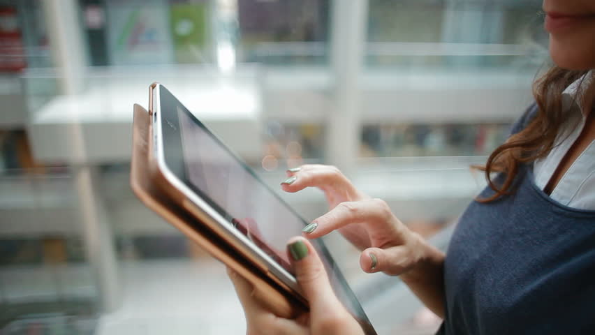 Young business woman in an elevator with a Tablet PC. close-up | Shutterstock HD Video #4946627