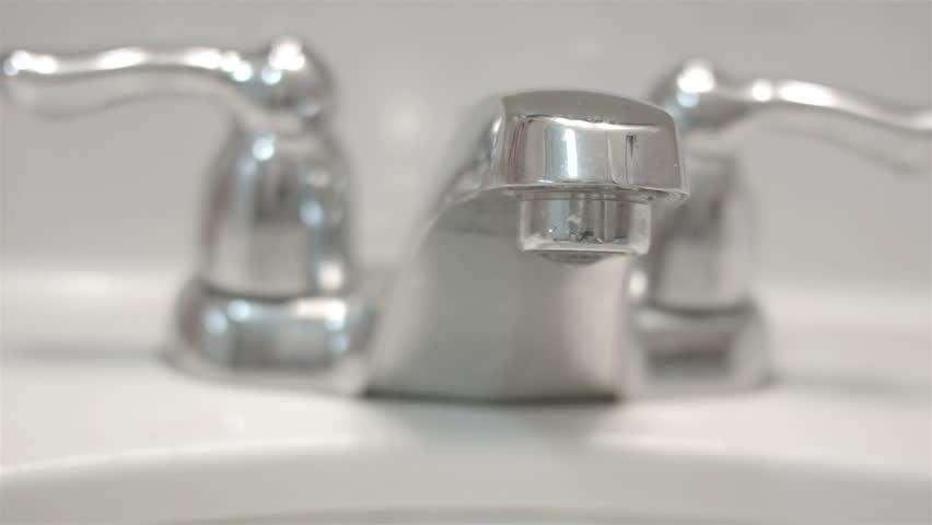 Stock Video Clip of Water tap leaking bathroom sink wasteful HD ...