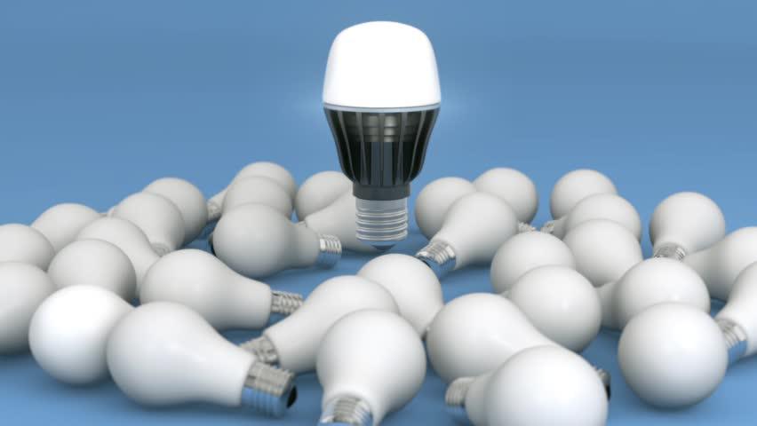 New generation LED light floating over incandescent light bulbs