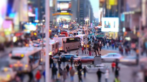 Zooming busy city traffic time lapse of Times Square, tilt shift and circular blur.