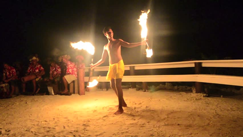 Polynesian Pacific Island Tahitian fire male dancer during a show in Aitutaki lagoon Cook Islands.