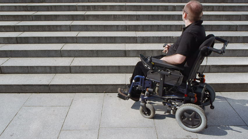 stair electric chair. Disabled Person In An Electric Wheelchair Approaches Stairs High Angle View - HD Stock Footage Clip Stair Chair