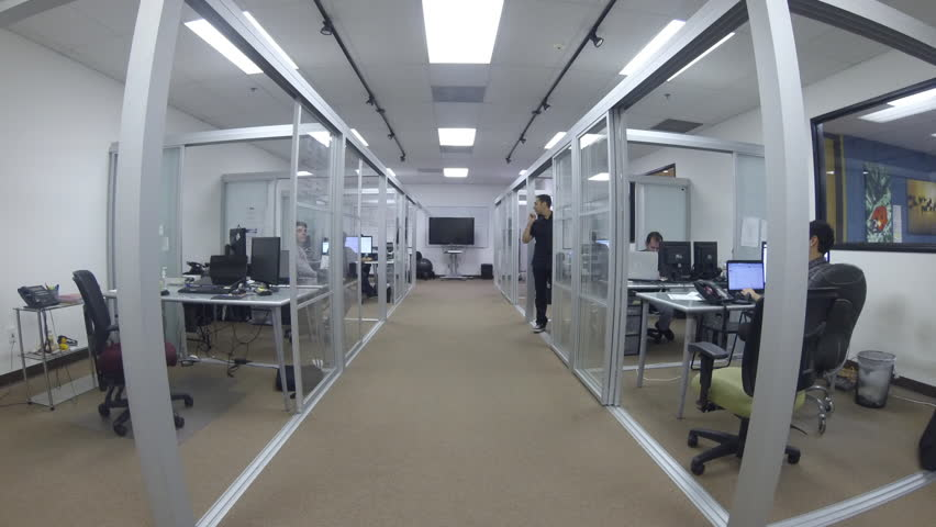 Contemporary Office Space. Timelapse Of Employees In A Business Environment  Working At Their Desks.