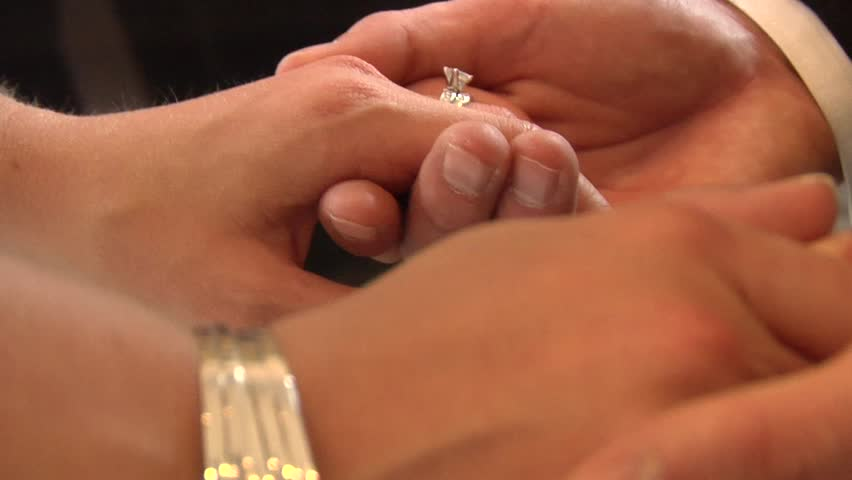 bride and groom holding hands close up on wedding ring #503683