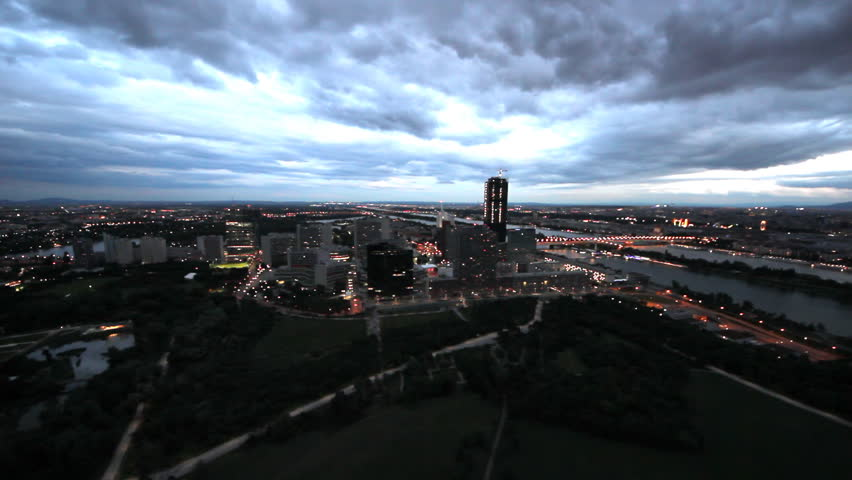 Clouds passing over Vienna modern city, night view