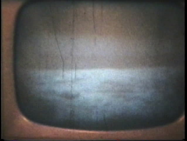 """MOON - JULY 20. 1969: Neil Armstrong and Buzz Aldrin's famous """"moon walk"""" in July 1969 as seen through an old television film with an 8mm camera.  (1969 - vintage 8mm film footage)"""